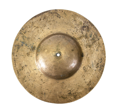 backside: Close up of an old cymbal on isolated background.Brass cymbal isolated