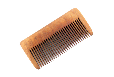 Wooden comb isolated on white background.Hair comb isolated
