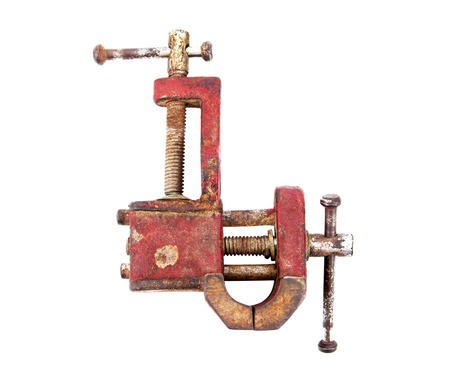 vise: Old mechanical hand vise clamp isolated on white background.Vise isolated Stock Photo
