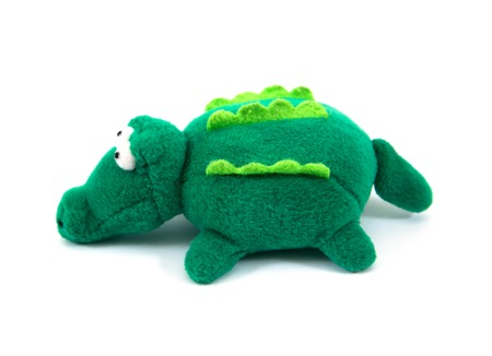 Green crocodile fabric doll isolated on white background.Fabric crocodile toy isolated Stock Photo