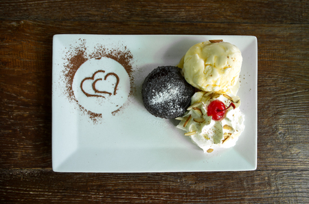 Chocolate lava cake  with vanilla ice cream on dark table background