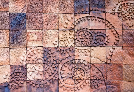 earthenware: Vintage earthenware wall tiles with tree branches patterns handcraft from Thailand public.Earthenware wall.Earthenware bricks wall.Earthenware tiles wall