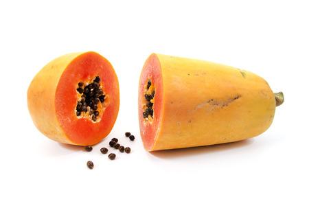 black and white photograph: Papaya isolated on white background.Ripe papaya isolated.Yellow papaya isolated.Fresh papaya isolated.Papaya with seeds isolated