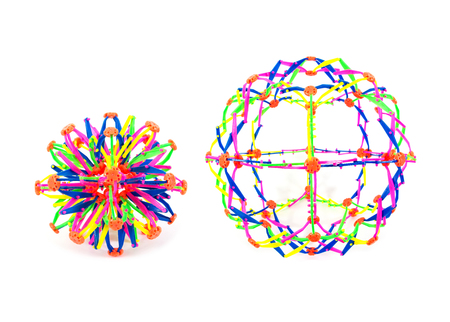 pedagogical: Two plastic stretch ball toy isolated on white background.Colorful stretch ball toy isolated. Stock Photo