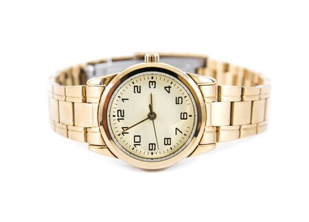 chronograph: golden watch isolated on a white background.Woman gold watch isolated