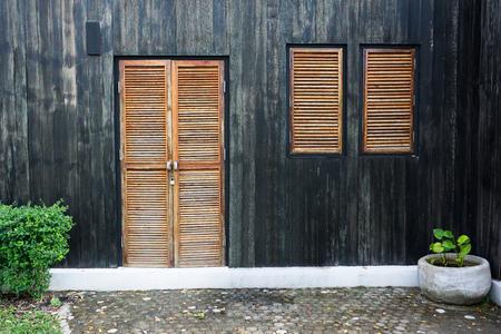 old door and window.Wooden door and window with wooden wall Stock Photo