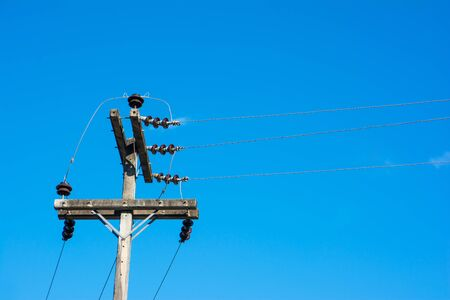 Electric pole at sky background.High voltage post.High-voltage tower at sky background. Stock Photo