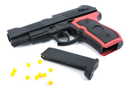 Gun toy isolated on white background.Pistol gun toy isolated.Pistol toy with bullet isolated Stock Photo