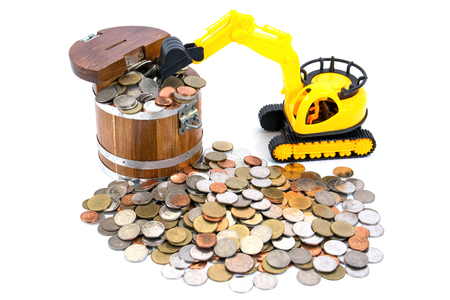 Bulldozer toy scoop up coins into saving box isolated on white background in saving concept
