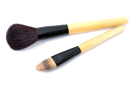 grooming product: wooden make-up brushes isolated on white background.Makeup brushes isolated.Make up brushes isolated Stock Photo