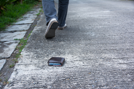Wallet drop on the road when walking