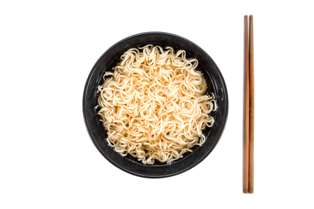 Noodles in bowl with chopsticks beside isolated on white background Stock Photo