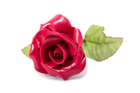 Artificial red rose flower isolated on white background