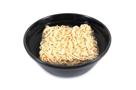 Intant noodles in bowl isolated on white background