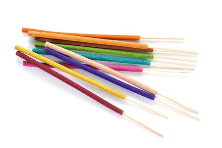 Closeup of colorful incense sticks isolated on white background