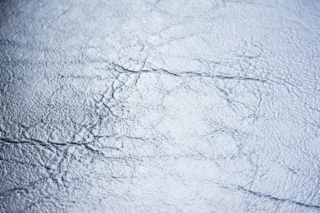 Gradient silver blue leather texture background. Silver leather texture