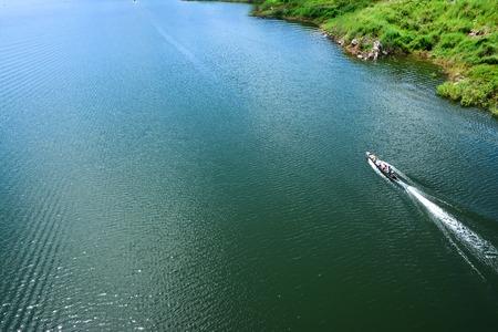 Small fishing boat at Mae Kuang Udom Thara dam in Chiang mai.Thailand