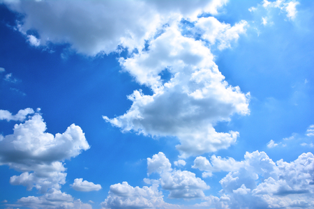 Beautiful blue sky with clouds background. Bright clouds in the blue sky