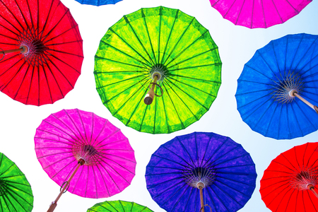 Floating umbrella in the air background. Colorful paper umbrella floating.