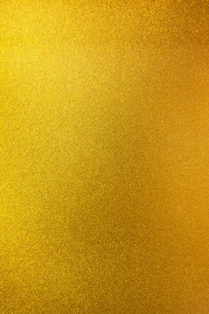 Vertical gold texture background. Vertical smooth gold texture surface