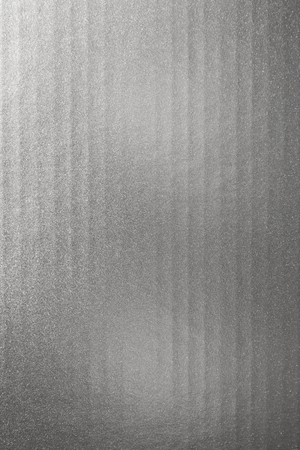 Vertical bright and dark silver texture background. Silver paper texture surface