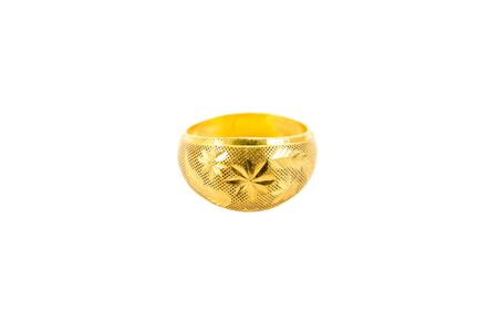 Gold ring isolated on white background. Carving gold ring with flowers pattern isolated