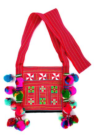 Close up tribal bag isolated on white background. Colorful tribal shoulder bag isolated Stok Fotoğraf