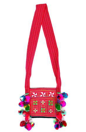 Tribal bag isolated on white background. Colorful tribal shoulder bag isolated