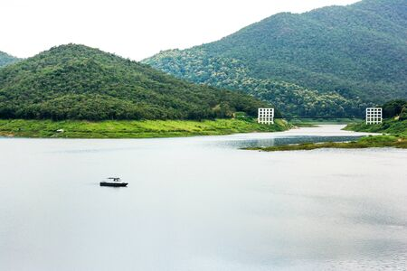 Scenery view of Mae Kuang Udom Thara dam with ship and suspension bridge background in Chiang mai,Thailand