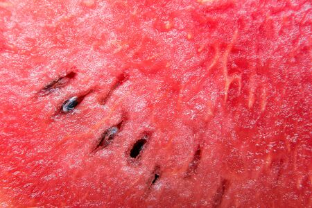 Close up watermelon texture background. Closeup red watermelon texture surface with seed