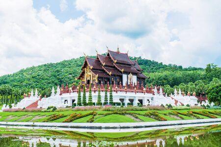 Royal pavilion at Royal Park Rajapruek in Chiang Mai province,Thailand. Chiangmai Royal  Pavilion ( Ho Kham Luang ) architecture with tree and blue sky background