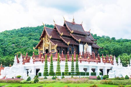 Closeup of Royal pavilion at Royal Park Rajapruek in Chiang Mai province,Thailand. Chiangmai Royal  Pavilion ( Ho Kham Luang ) architecture with tree and blue sky background Stok Fotoğraf