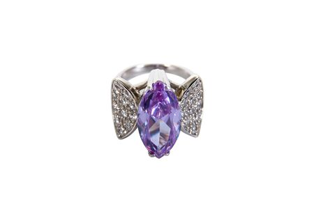 Silver ring with gem isolated on white background. Decoration silver ring with big purple ruby isolated