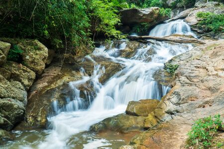 Mae Sa waterfall in Chiang Mai, Thailand. Beautiful Maesa waterfall in cool day light with green trees in Chiangmai province, Thai Stockfoto