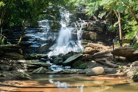 Tat Mok waterfall in Chinag Mai, Thailand. Tatmok or Tard mok waterfall at Mae Rim District in Northern Thailand.