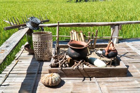 Northern native Thailand kitchen with rice field background. North local Thai kitchen with ancient kitchenware