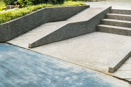 Ramp for the wheelchair and stairs for normal people adjoining. Stairway for wheelchair or disabled person with step background Banco de Imagens