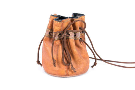Old leather drawstring bag with brown string tied isolated on white background. Small old brown leather drawstring bag isolated