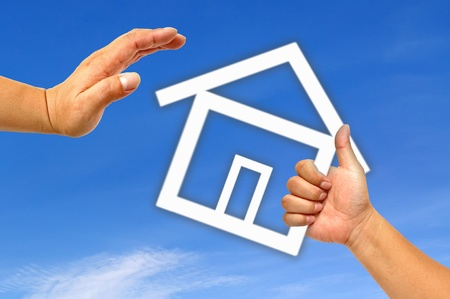 Hand and icon house Stock Photo - 9652338
