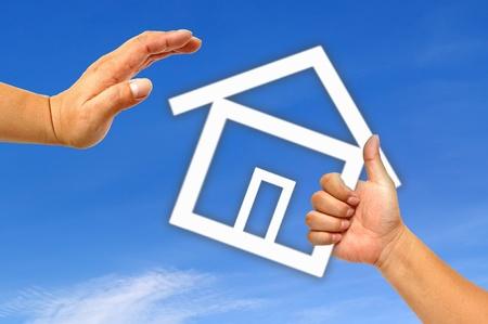Main et icône de la maison