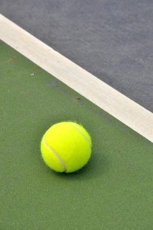 Tennis ball on a tennis court photo