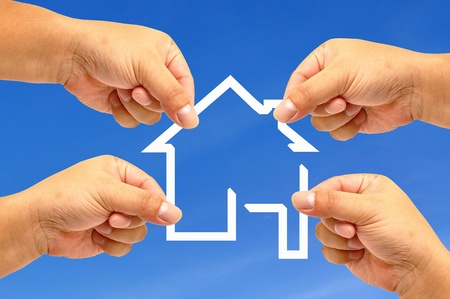 Hand and icon house Stock Photo - 9699338