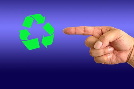 Recycling symbol on hand photo