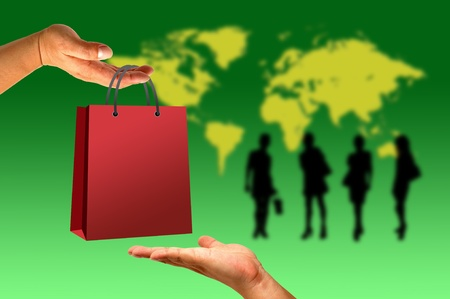 Shopping bag in hand on world and women background