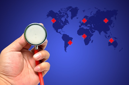 Stethoscope on a world background ,Save the world photo