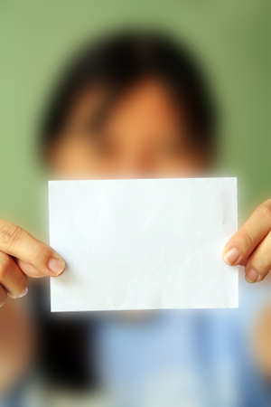 woman holding a blank business card in front of her  photo