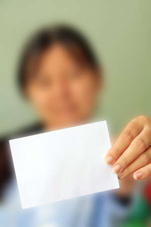 woman holding a blank business card in front of her Stock Photo - 9845316