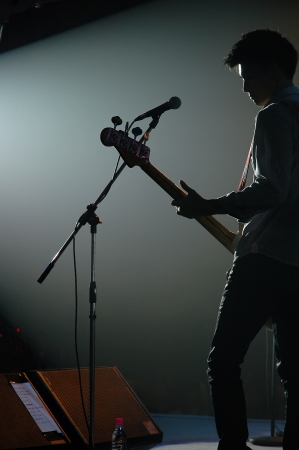 guitarist of a pop band with a guitar Stock Photo - 9845235