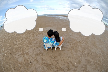 Couple enjoying the beach and dreaming Stock Photo - 9845063
