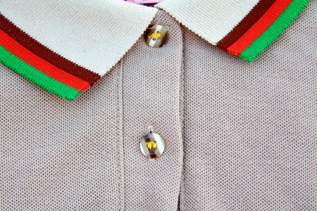 A part of a shirt with buttons photo